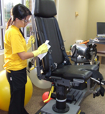 Space Management employee doing medical suite cleaning