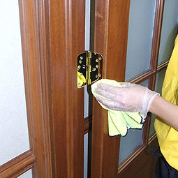 Space Management staff cleaning door hinge